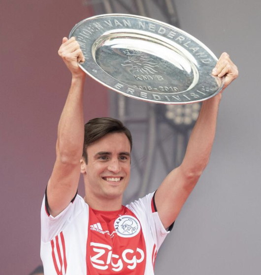 Ajax's Nico Tagliafico lifts the Eredivisie title to complete the domestic double